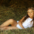 Stock Photo: Girl child in haystack