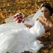 Beautiful bride in autumn forest — Stock Photo
