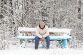 An attractive middle-aged gray man sitting on the bench — Stock Photo