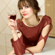 Stock Photo: Usual quiet and natural girl with wine at home