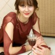 The usual quiet and natural girl with wine at home - Stock Photo