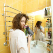 Calm fun cheerful girl dries hair in the bathroom — Stock Photo