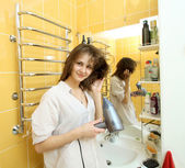 Calm fun cheerful girl dries hair in the bathroom — Stok fotoğraf