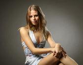 Attractive fashionable girl in a denim vest — Stock Photo