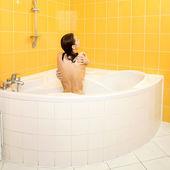 Positive beautiful girl taking a shower — Стоковое фото