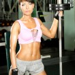 Fitness model trains in the gym — Stock Photo