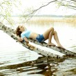 Teen girl dreams lying on the tree — Stock Photo