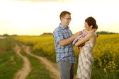Mother and father with their little daughter in a field — Stock Photo