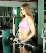 Fitness model girl in the gym — Stock Photo