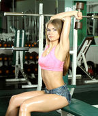 Fitness model girl in the gym — Stok fotoğraf