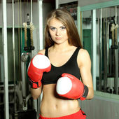 Sweet ordinary girl with boxing gloves — Stock Photo