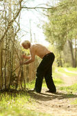 Old man plants a tree — Stock Photo