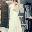 Girl in a wedding dress makes fitting in the clothing design studio — Stock Photo