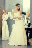 Girls in a wedding dress make fitting in the clothing design studio — Stock Photo