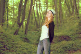 Attractive pretty girl in the forest — Stockfoto