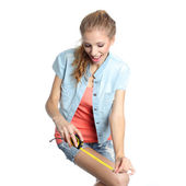 Girl ready to measure anything with a tape measure. — Stock Photo