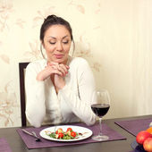 Woman looks doubtful on salad in a plate — Stock Photo