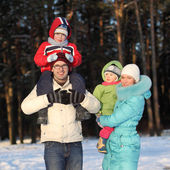 Young family walks winter — Stock Photo