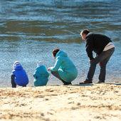 Family near water — Stock Photo