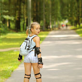 Funny girl rollerblading — Stock Photo