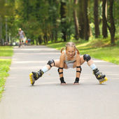 Little girl falls on roller skates — Stock Photo