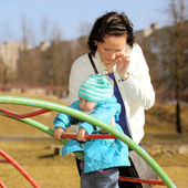 Inattentive mother talking on the phone and forgot about the child — Стоковое фото