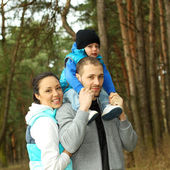 Beautiful young family having fun outdoors — 图库照片