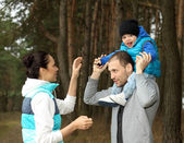 Beautiful young family having fun outdoors — ストック写真