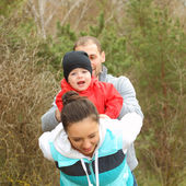 Beautiful young family having fun outdoors — Foto Stock