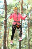 Linda garota mascarada de escalada — Fotografia Stock