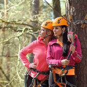Two beautiful attractive girls in a special outfit have been climbing — Stock Photo