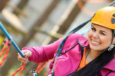 Beautiful girl in the outfit climbing climbs — Stock Photo