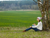 Ordinary hipster girl writing in a notebook — Stock Photo
