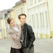 Young fashion couple posing outdoor — Stock Photo