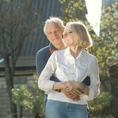 Couple of grandparents embracing — Stock Photo