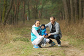 Portrait of a beautiful cheerful young family — Foto Stock