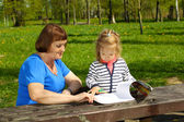 Grandmother and granddaughter paint — Stock Photo