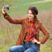 Girl photographs yourself — Stock Photo