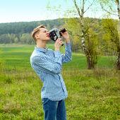 Guy shooting film — Stock Photo