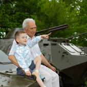 Family on military vehicle — Stockfoto