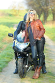 Couple with motorcycle — Photo