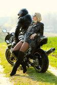 Couple on bike — Stock Photo