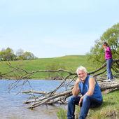 Family near river — Stock Photo