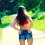 Summer girl in denim shorts — Stock Photo #50366649
