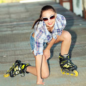 Beautiful girl on roller skates — Stock Photo