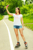 Girl on roller skates photographed herself — Stock Photo