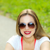 Sexy brunette woman in sunglasses — Stock Photo