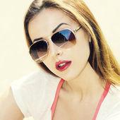 Sexy brunette woman in sunglasses — Stock Photo