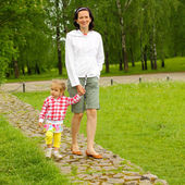 Mom and daughter walking in park — Stock Photo