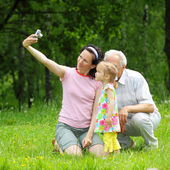 Grandfather, daughter and granddaughter are photographed — Stock Photo